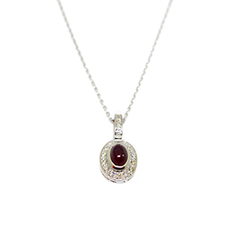 Gold Pendant: Cabochon Ruby and Diamonds